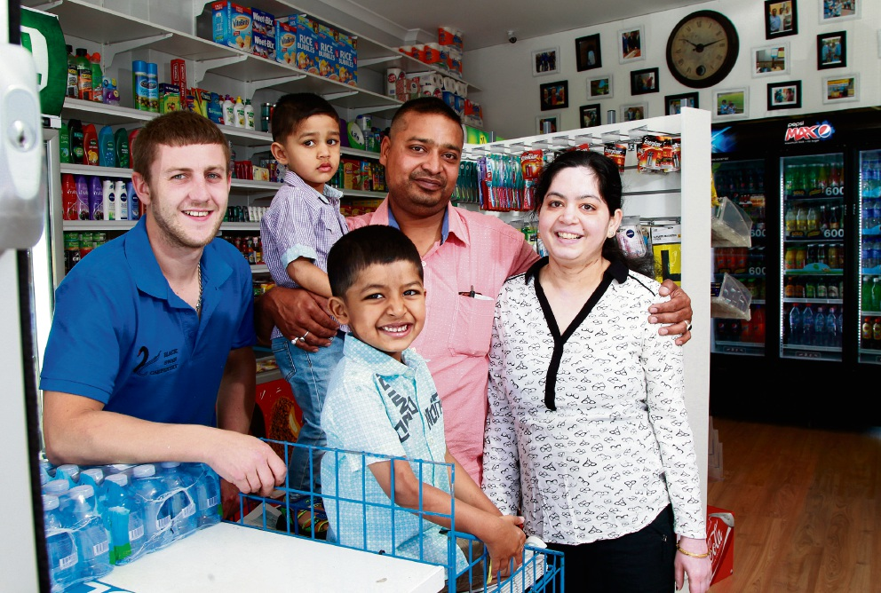 Busy Bee Deli owner Gautam 'Gem' Gautam with his wife Roshni and their children Ganak (2) and Girik (4, front) and Joshua Wright, the carpenter who helped set the store up. Picture: Marie Nirme
