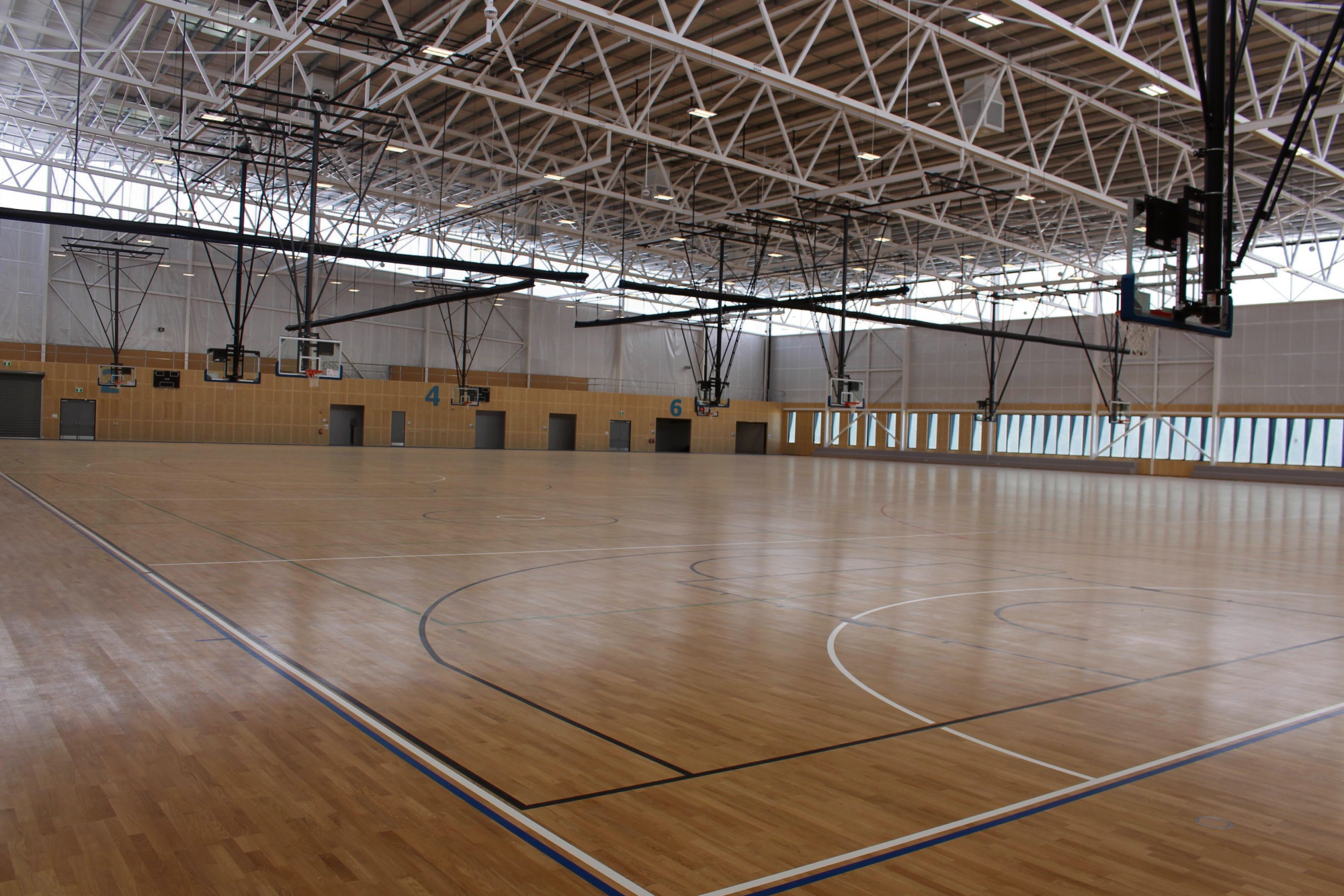 The multifunctional indoor training stadium with six basketball courts and a 100m running track.