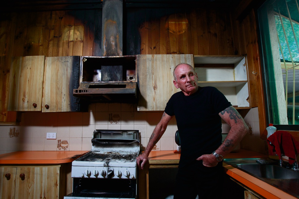 At least the Toyota was saved: Maurice Enright in the burnt-out kitchen of his Armadale home.