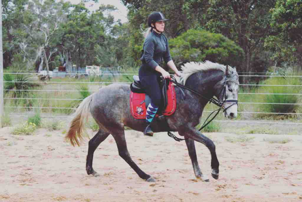 Clairice Stewart-Lyons seen here riding Onyx.
