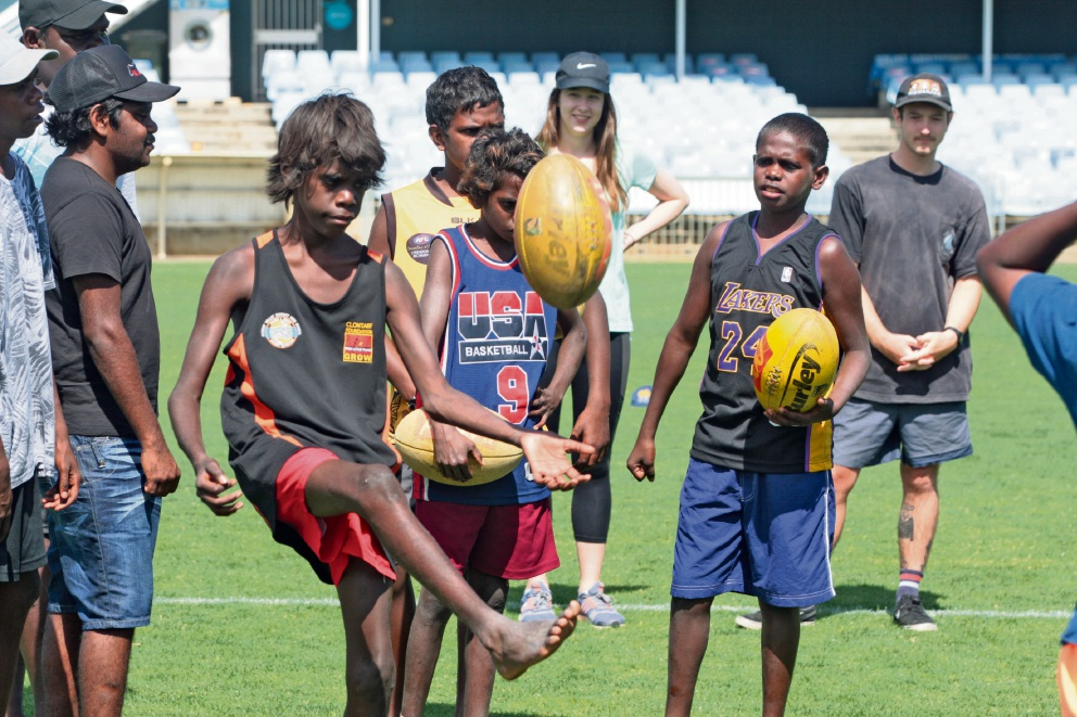 Youngsters from the Mowanjum Aboriginal community, have fun playing footy. Pictures: Bruce Hunt