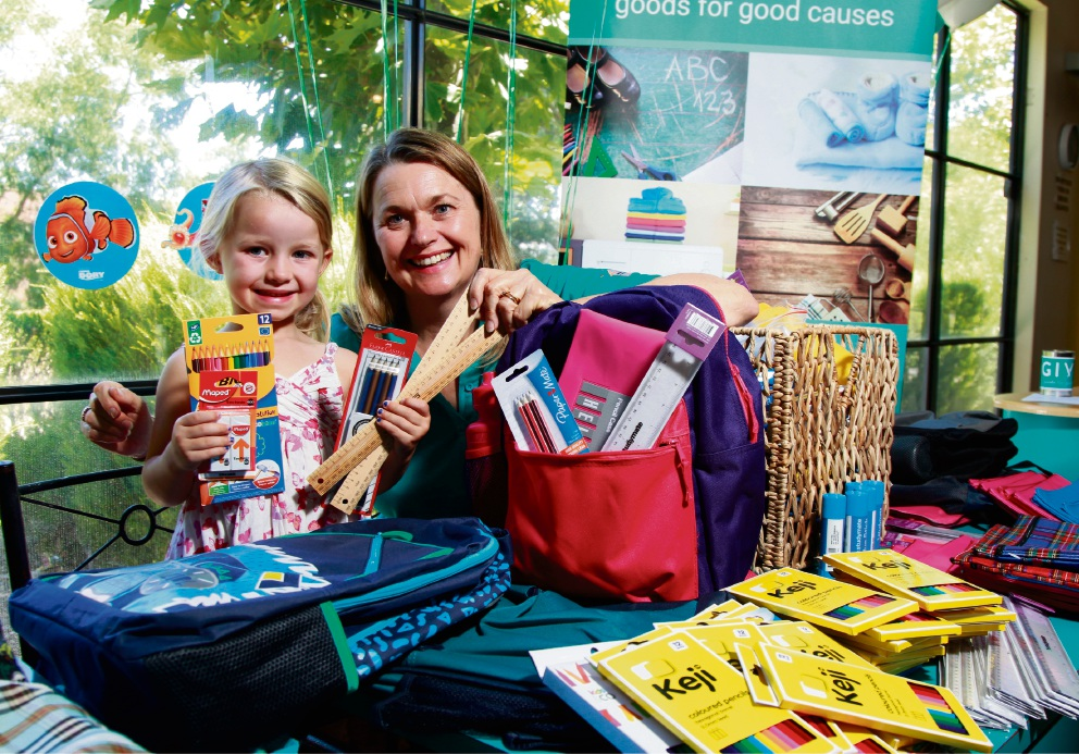 Mrs Presser said she was pleased the items would benefit disadvantaged children.GIVIT's Anna Presser with Sophie Jeffreys (3). Picture: Marie Nirme                                     www.communitypix.com.au        d464479