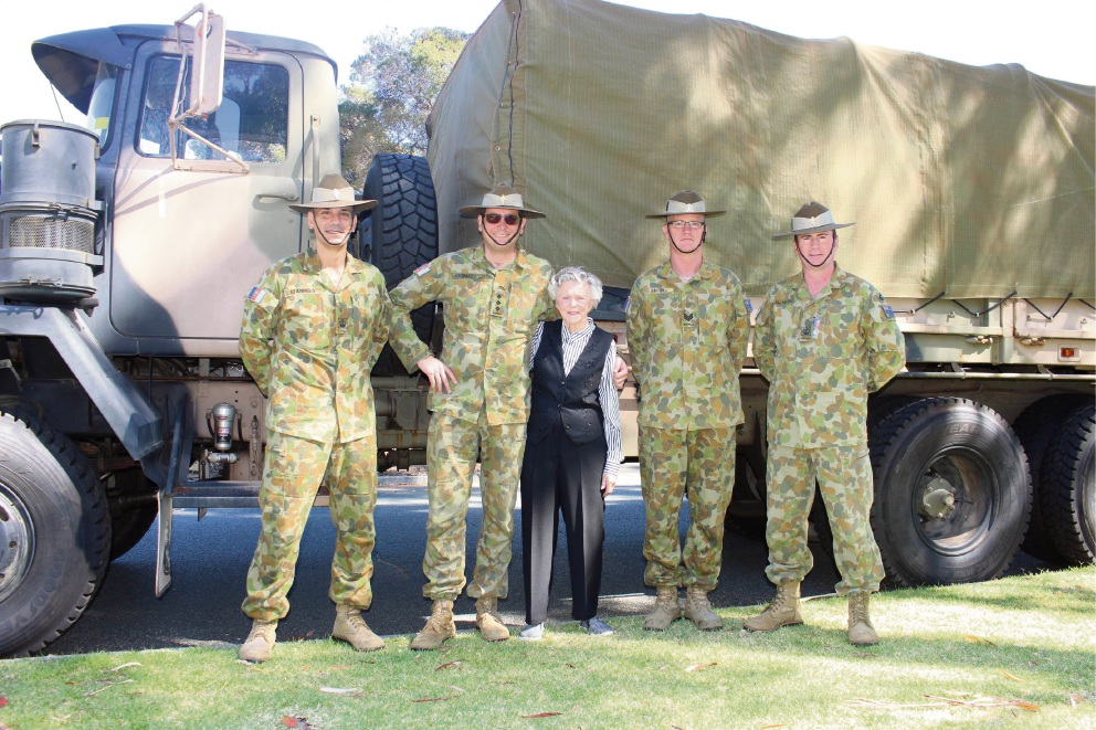 Kate McKay (centre) with Joint Logistics Unit West warrant officer classic two Aris Ioannidis, Capt Ben Oakes, Sgt Jeffrey Smith and warrant officer class two Mark Allanson