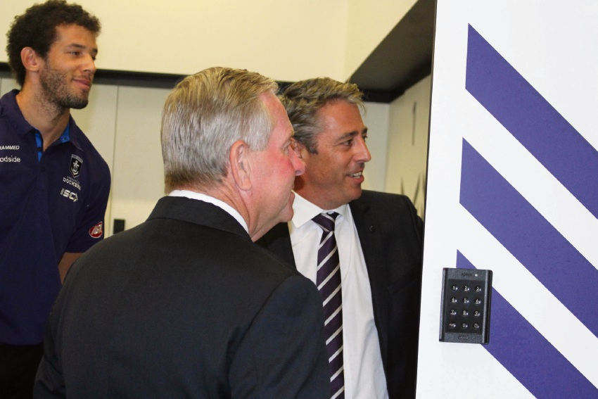 Zac Clarke and chief executive Steve Rosich show Premier Colin Barnett through the lockers at their new home at Cockburn Central.