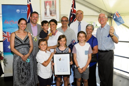 Troy Pickard and Moore MHR Ian Goodenough with 2017 Citizen of the Year Pina Pettinicchio and family;