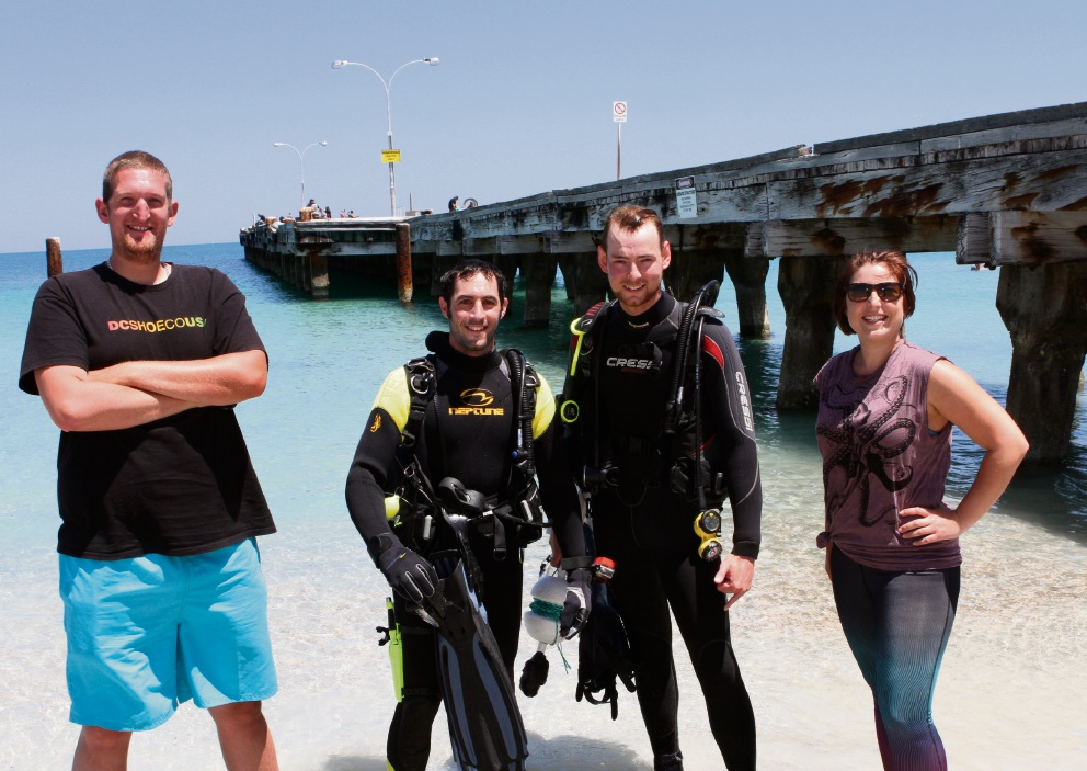 Clean-up organisers Connor Smith and Claire Hinchliffe with divers Anthony Kouzinas and James Wragg. Picture: Robin Kornet  d464249