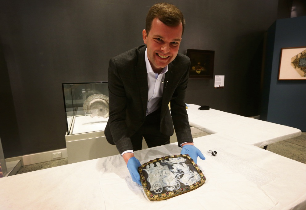 A 1700-year-old cameo is unveiled by Ben van den Bercken from the National Museum of Antiquities of Leiden with WA Maritime Museum exhibition curator Corioli Souter. Picture: Matt Jelonek.