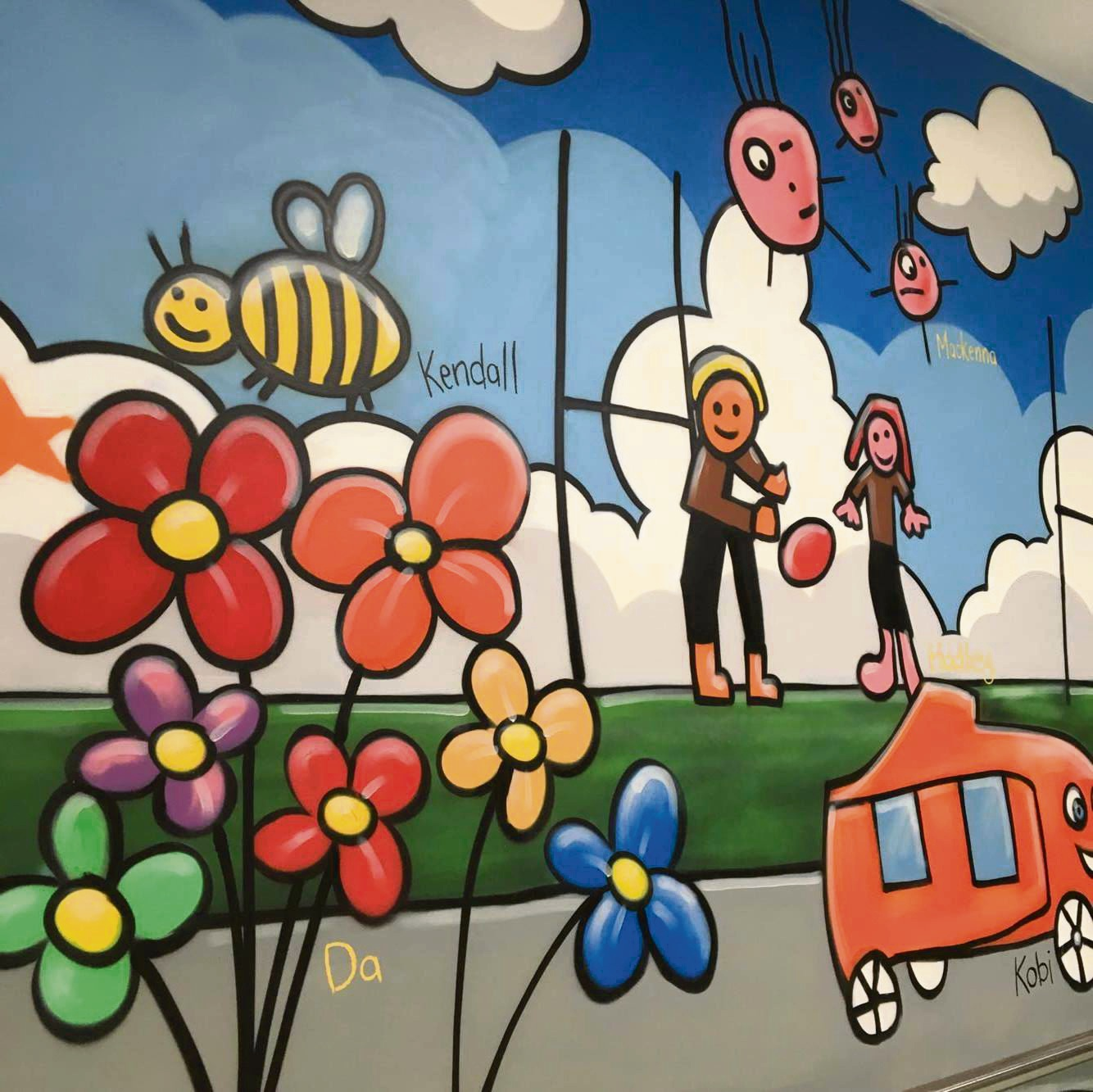 Graffiti artist brings children's artworks to life at Whitford City shopping centre with mural