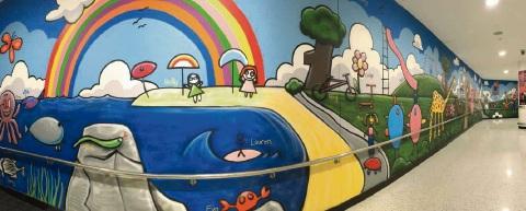 The community mural. The art workshops.
