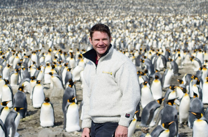 Steve Backshall with king penguins.