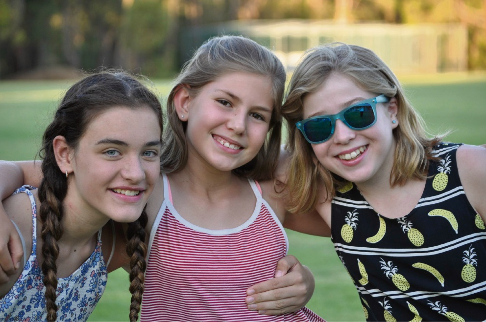 Three young friends enjoying a movie under the stars at last year's series. Picture: Shire of Mundaring
