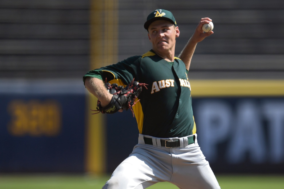 Josh Hendrickson winds up a pitch for Australia in its contest against Japan earlier this week. Picture: World Baseball Softball Confederation.