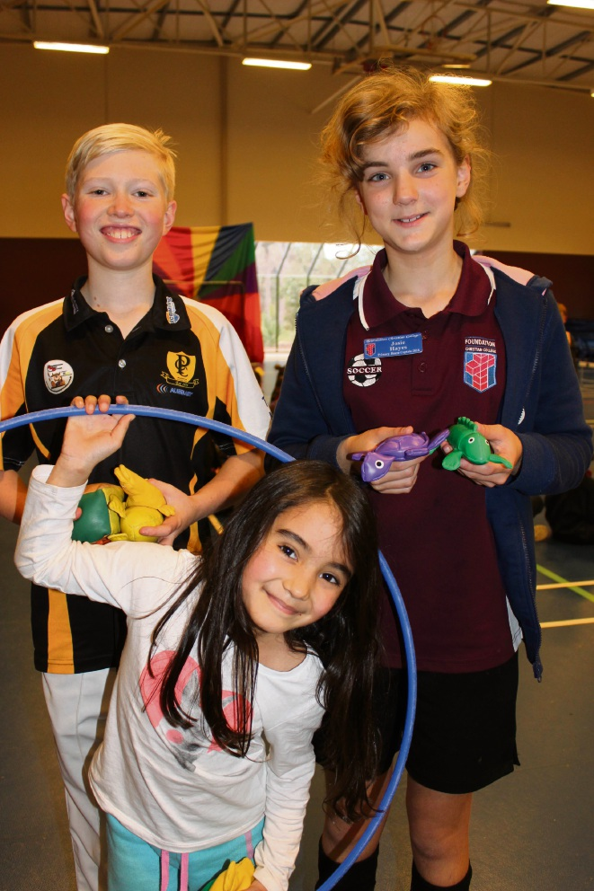 Foundation Christian College students William Rugendyke (Year 6), Milarni Chong (Year 1) and Josie Hayes (Year 6).