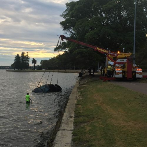 The woman's car being removed from the Swan River yesterday. Photo: Paul Eteen-Bliss.