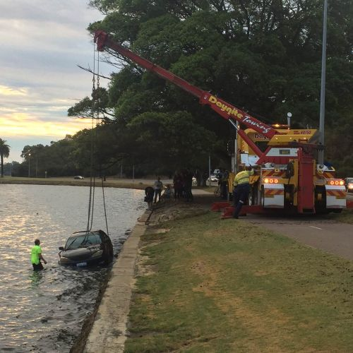 The woman's car being removed from the Swan River yesterday. Photo: Paul Eteen-Bliss