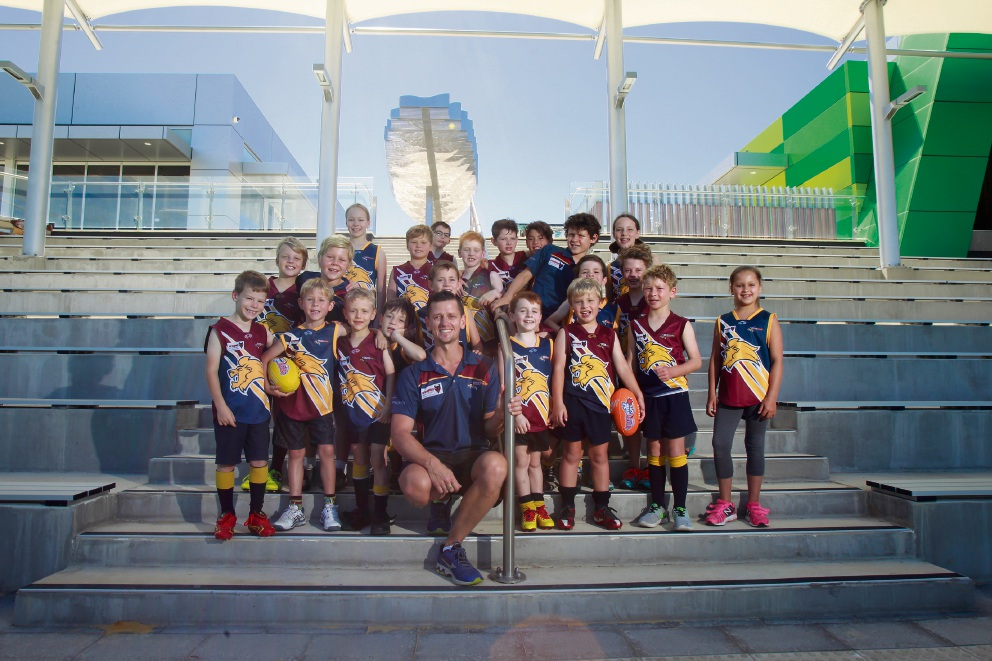 Olly Hurst (Head of Members and Coach Manning Rippers FC) with players from Manning Rippers FC who will call the new Manning Community Centre their home ground Picture: Marie Nirme www.communitypix.com.au   d464476