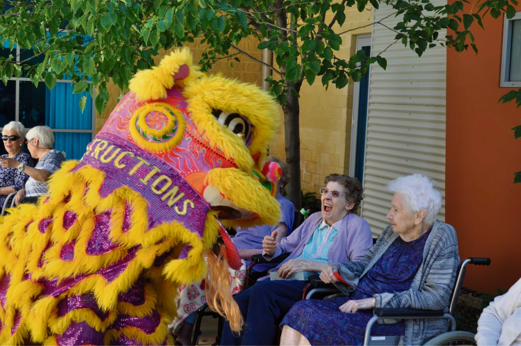 Narice O'Connor and Ruth May enjoying the dragon dance
