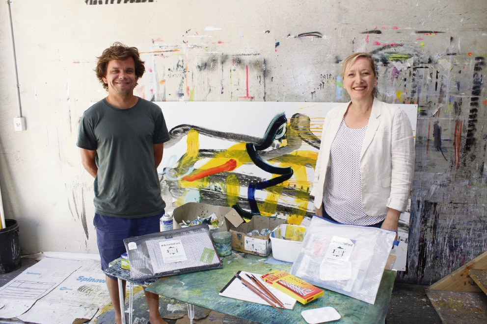 Rockingham artist Andy Quilty and Military Arts Program founder Leza Howie with some of the art packs that will be sent to HMAS Arunta.