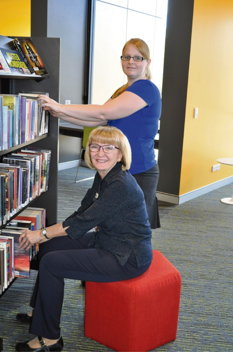 Boya Library staff Amanda Rowe (standing) and Teresa Johnson.