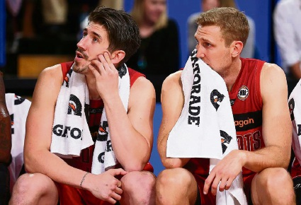 Greg Hire (left) on the bench with Wildcats superstar Shawn Redhage last year. Picture: Getty Images