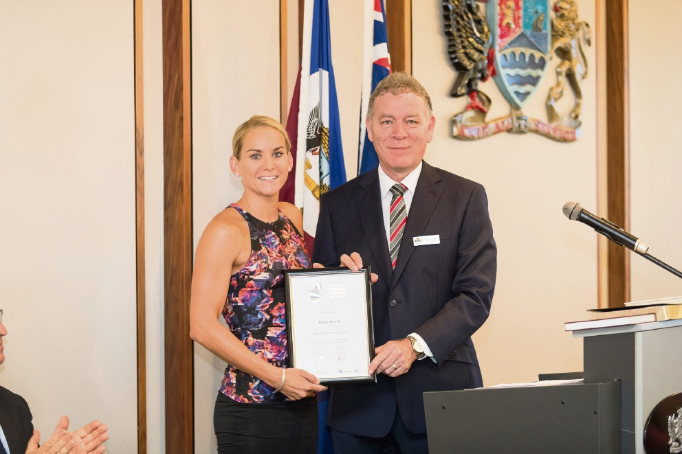 Renee Baker receives her Citizen of the Year award from Canning Deputy Mayor Lindsay Holland.