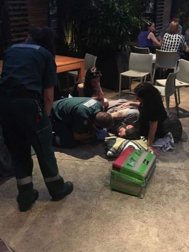 Paramedics attend to a man after a fight at the Boulevard Hotel in Floreat on Sunday night. Picture: Michael Stamp