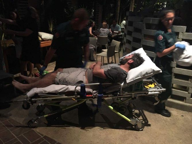 One of the men involved in a fight at the Boulevard Hotel on Sunday night on a stretcher after being attended to by paramedics. Picture: Michael Stamp