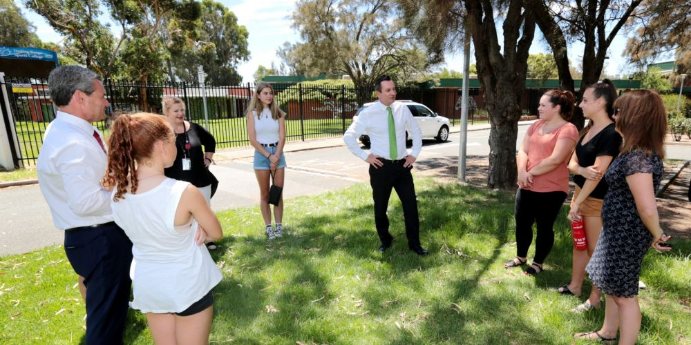 Mark McGowan talks to past students from the Darling Range Sports College in Forrestfield about the promise of funds for much needed upgrades at the college. Picture: David Baylis d464849