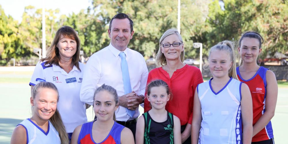 Fremantle Netball Association president Sondra Anderson, Opposition Leader Mark McGowan and Labor candidate for Bicton Lisa O'Malley with some of the thousands of girls who regularly use the Gibson Park facilities.