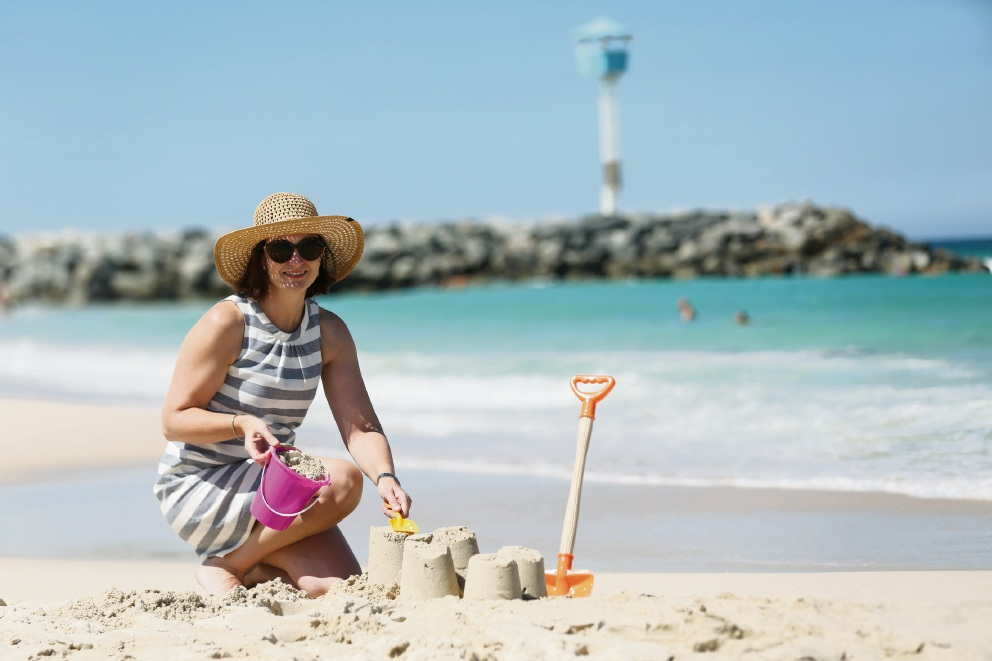 Mayor Keri Shannon making sandcastles as the Town of Cambridge gets ready for the Celebrate City Beach event this month. Picture: Andrew Ritchie d464892