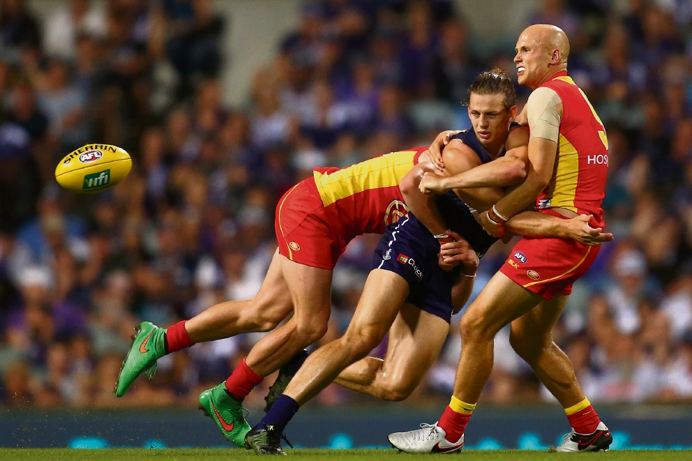 Fremantle had a tough game against Gold Coast; Nat Fyfe the meat in a Suns sandwich on Saturday night. Picture: Paul Kane/Stringer