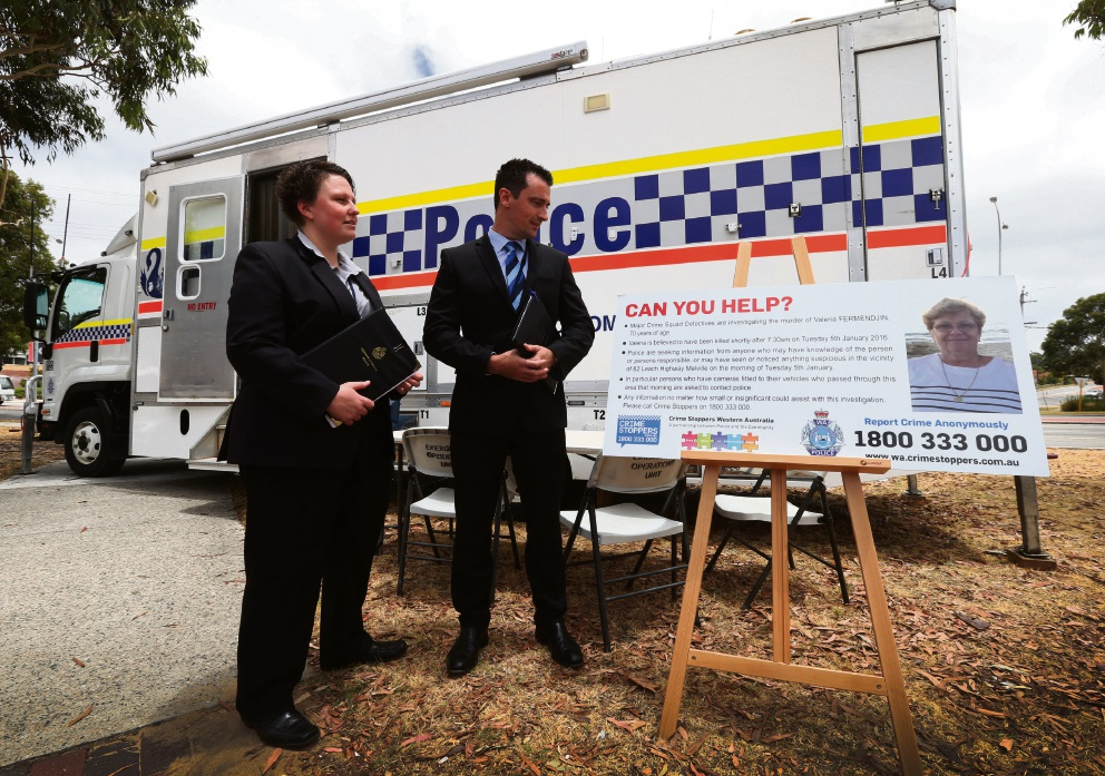Acting Detective Senior Sergeant Brett Fowler and Acting Detective Sergeant Lawler at the site of the mobile policing facility investigating the death of Valeria Fermendjin. Picture: Matt Jelonek.