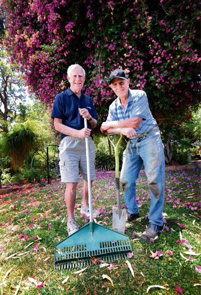 Barry Young and Tom Hogg prepare the garden for the concert on January 20 in Maida Vale. Photograph: David Baylis.