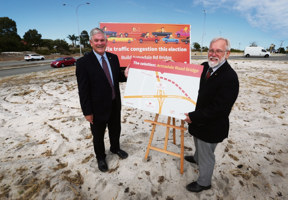 Mayor Logan Howlett and Mayor Henry Zelones at the site of the proposed bridge. Picture: Matt Jelonek