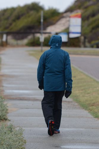 One walker was rugged up for worse weather. Picture: Jon Bassett