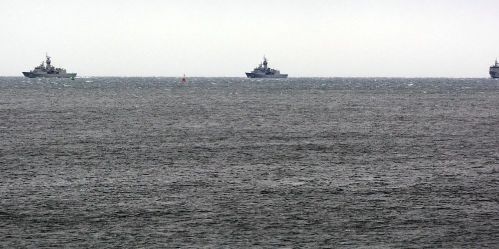 Frigates and a supply ship return. Picture: Jon Bassett