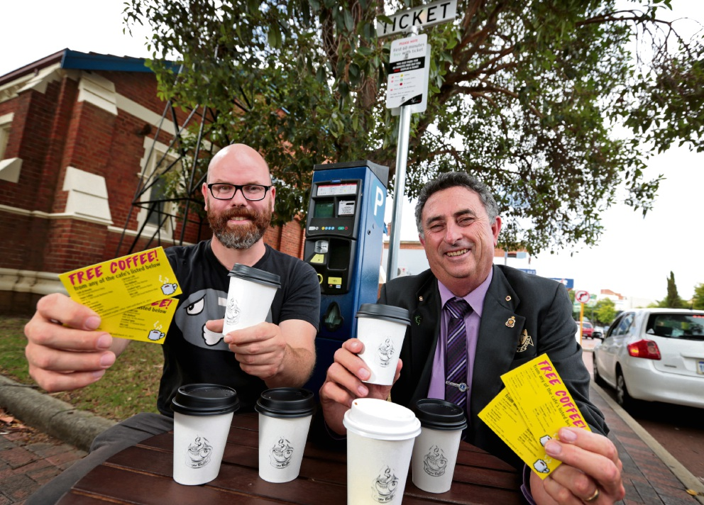 Carpe Coffee owner James Daly and City of Swan Mayor Mick Wainwright with coffee vouchers for people doing the right thing with parking. Picture: David Baylis                                            d465137