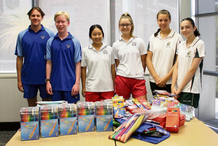 Mercedes and Trinity College students Nicholas Petagna, Hamish Gillespie, Eloise Kon-yu, Macy Sumich, Alexandra Del Casale and Gabriella Miocevich collected stationery for charity.