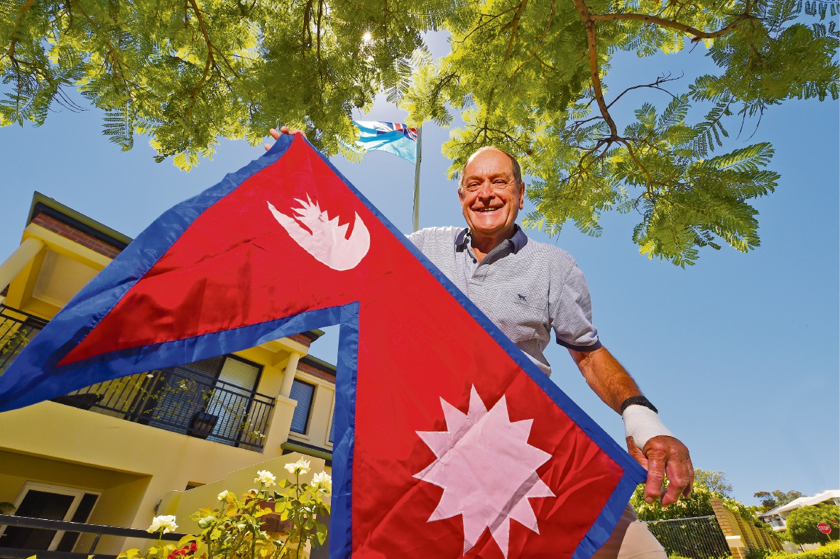 Barry MacKinnon with a Nepalese flag. Picture: Jon Hewson        www.communitypix.com.au d464896