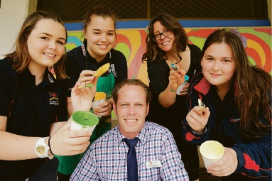 Breeanah Smallwood (Year 9), Anastasia Ilic (Year 9) with community artist Mel McVee with Kimberley Bertram (Year 8) and principal Steve Beaton (front). Picture: Andrew Ritchie