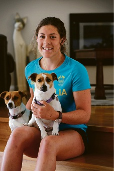 Fresh from the Rio Olympics Carine Swimmer Tamsin Cook, with her dogs Abbey and Tippi, is about to graduate into the senior ranks. Cook has been nominated for WA Junior Sports Star of the Year and WA Sports Star of the Year. Picture: Andrew Ritchie