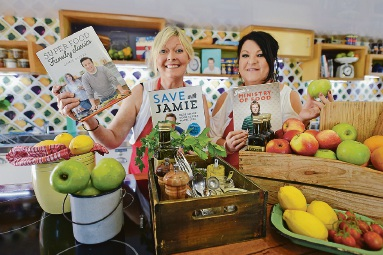 Sally Johnson and fellow student Narelle Walton in the Jamie's Ministry of Food Mobile Kitchen Picture: Jon Hewson