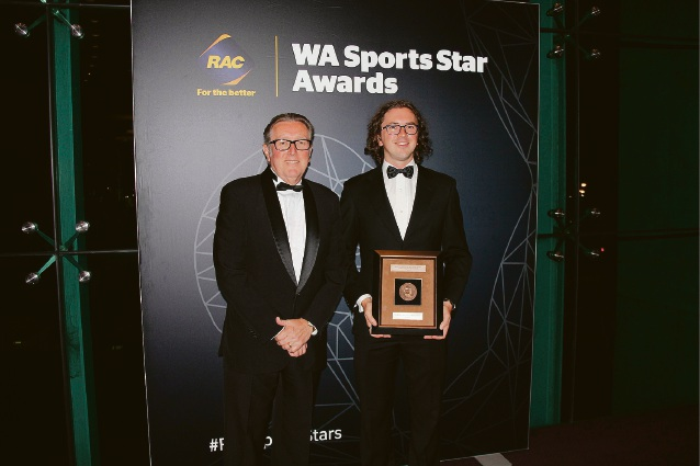 RAC Insurance chief executive officer John Stringer presents the Beyond Sport John Gilmour Medal to Curtin University Boat Club president Cameron Thorn.