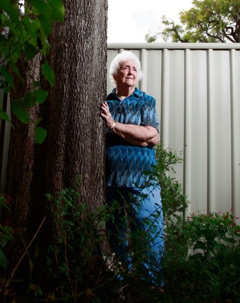 Bess Mitchell by the 50-year-old lily pilly tree planted by her late husband James. Picture: Marie Nirme