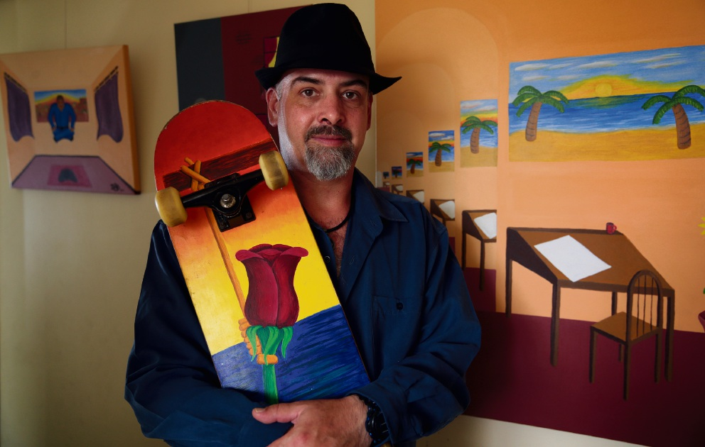 A Darling project: artist Darron Darling holding one of his painted skateboards.  Picture: Martin Kennealey           d465515