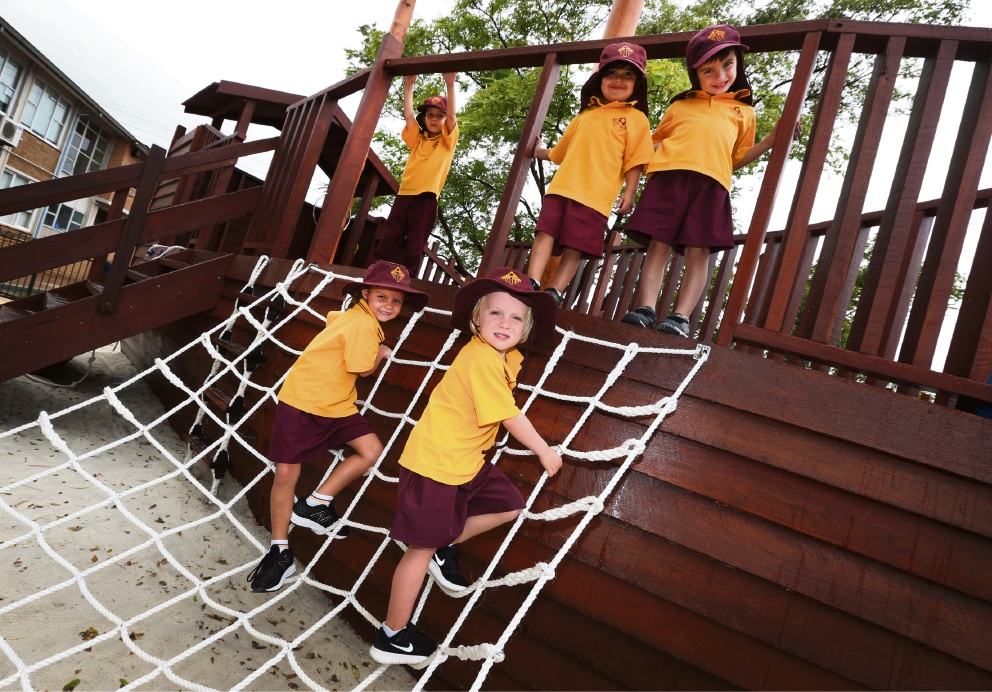 Pre-primary students Liam, Amelia, Angus with (front) Ella and Thomas enjoying Christ the King School's new adventure playground.  Picture: Matt Jelonek www.communitypix.com.au   d465077