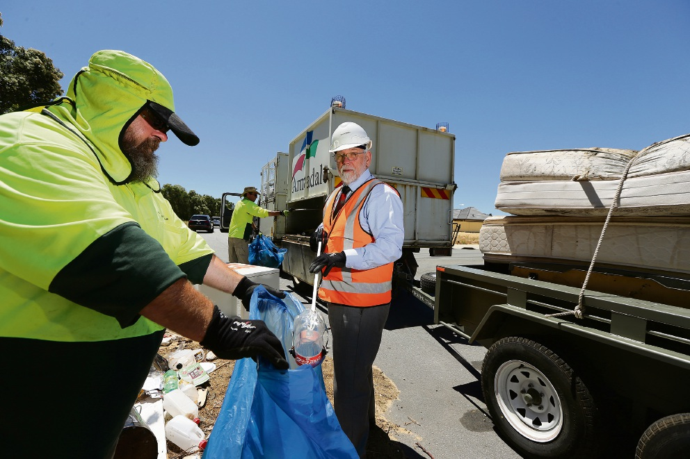 Mayor Henry Zelones, with council workers Guy Winters and Mark Guest, said the City  was taking action against illegal rubbish dumping. Picture: Will Russell           d465611