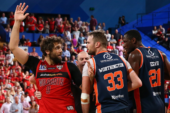Matt Knight of the Wildcats and Mark Worthington of the Taipans exchange words during game two of the semi finals between the Perth Wildcats and Cairns Taipans at Perth Arena last night. Picture: Paul Kane/Getty Images