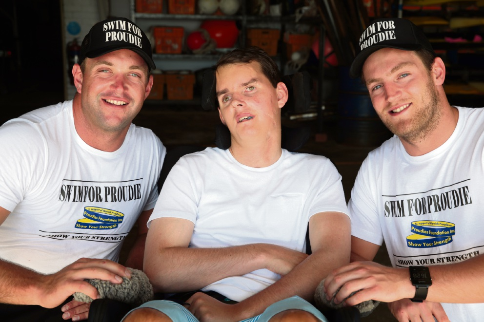 Warrick Proudlove (centre) is surrounded by support from his brother Mark (left) and friend Harry Garland.  Picture: Martin Kennealey www.communitypix.com.au   d465331