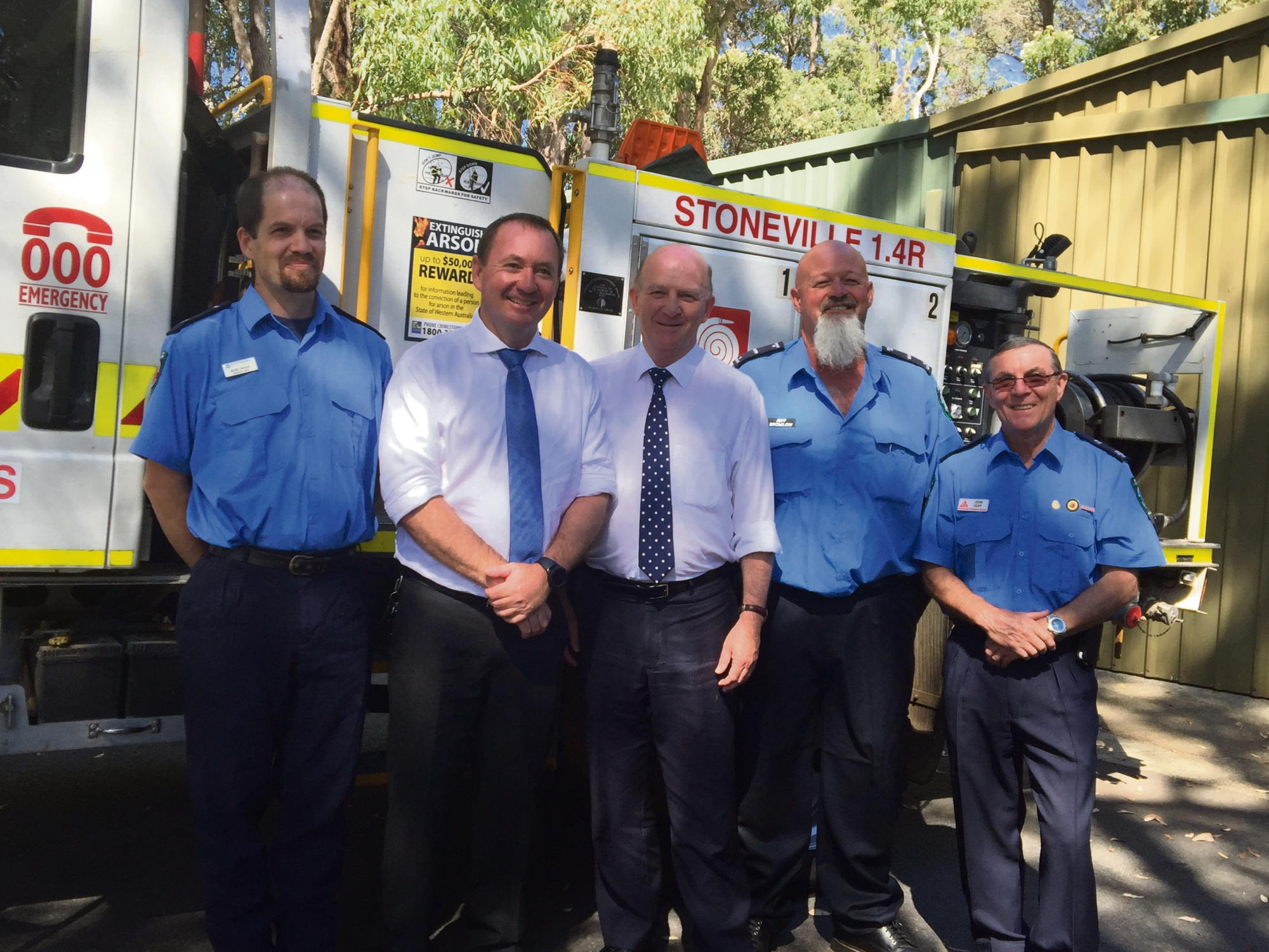 Emergency Services Minister Joe Francis and Kalamunda MLA John Day with members of the Stoneville Volunteer Bushfire Brigade.